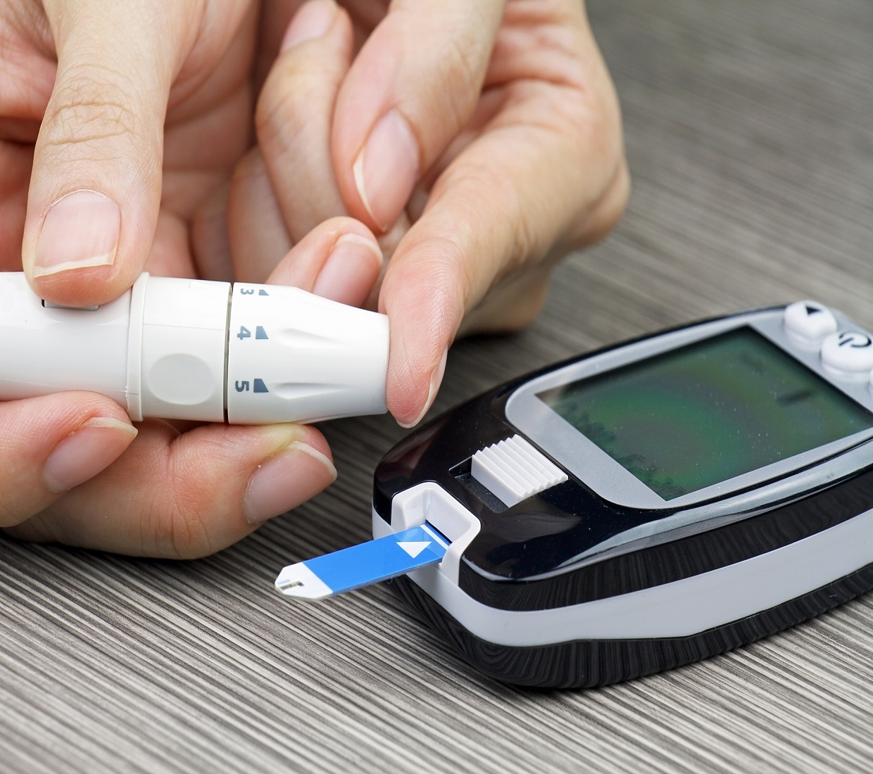 Finger testing with blood glucose machine