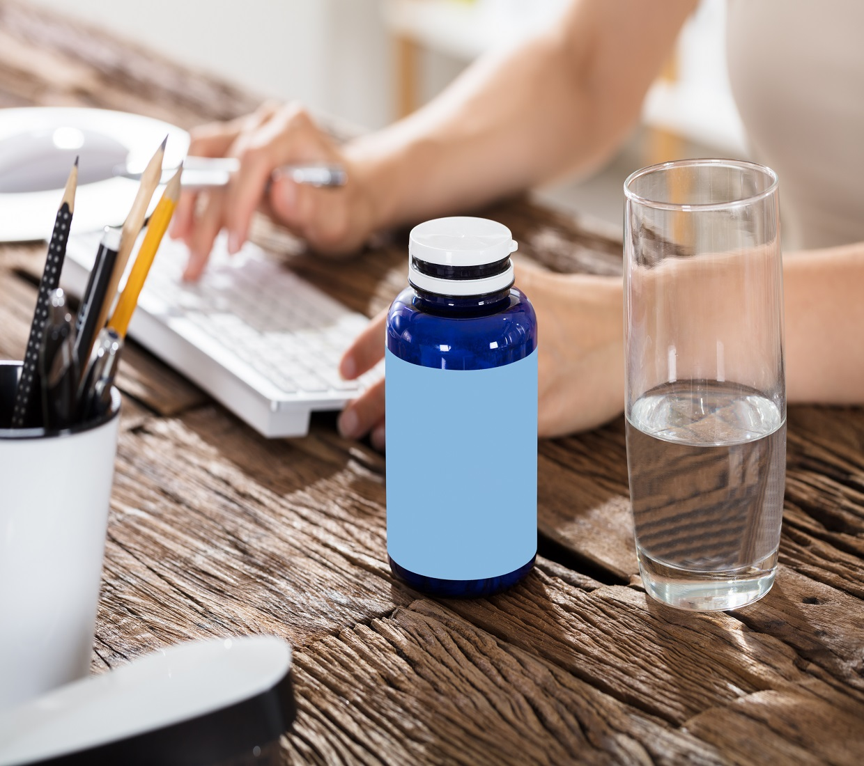 Pill Bottle with a glass of water