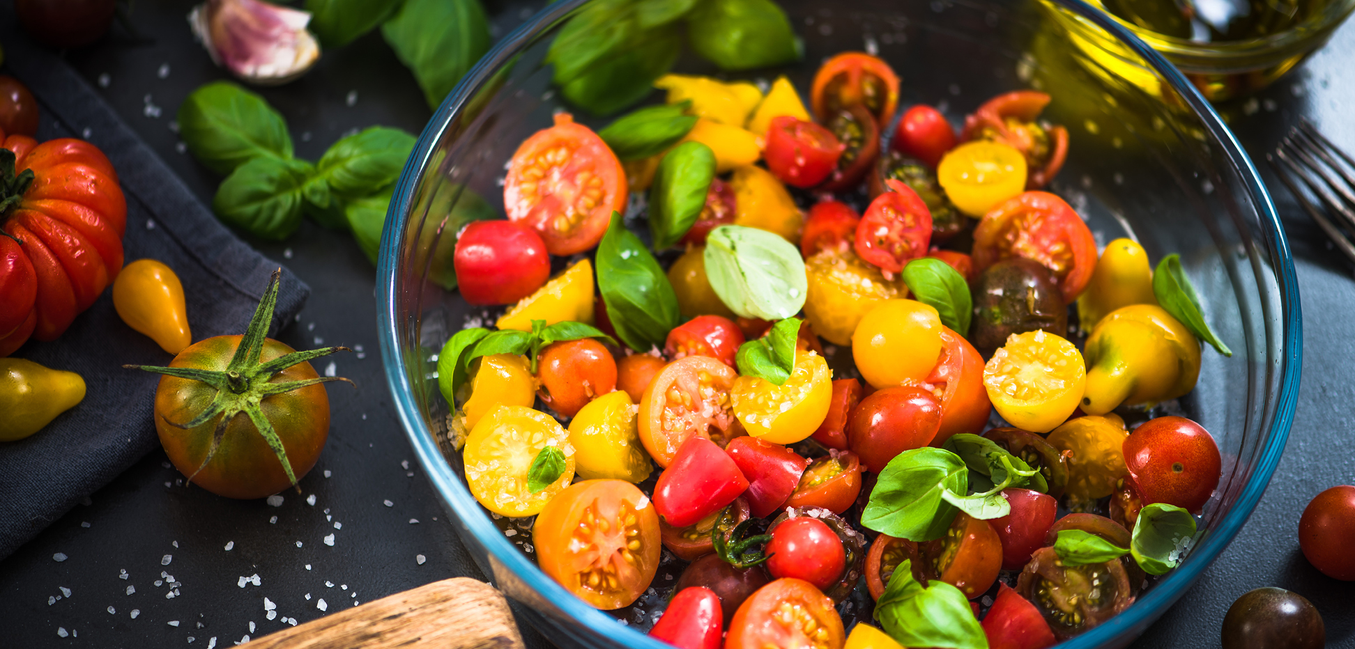 Glass bowl filled with bright colorful cherry tomatoes
