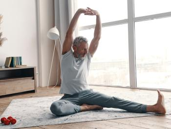 middle age man doing yoga