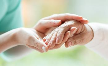 senior woman hand in young woman's hand